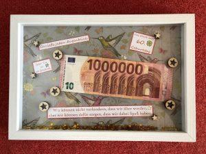 Geldgeschenk im Rahmen 1 Million Euro